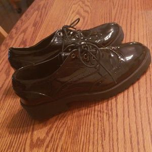 Lightly worn. Black patent leather oxfords.